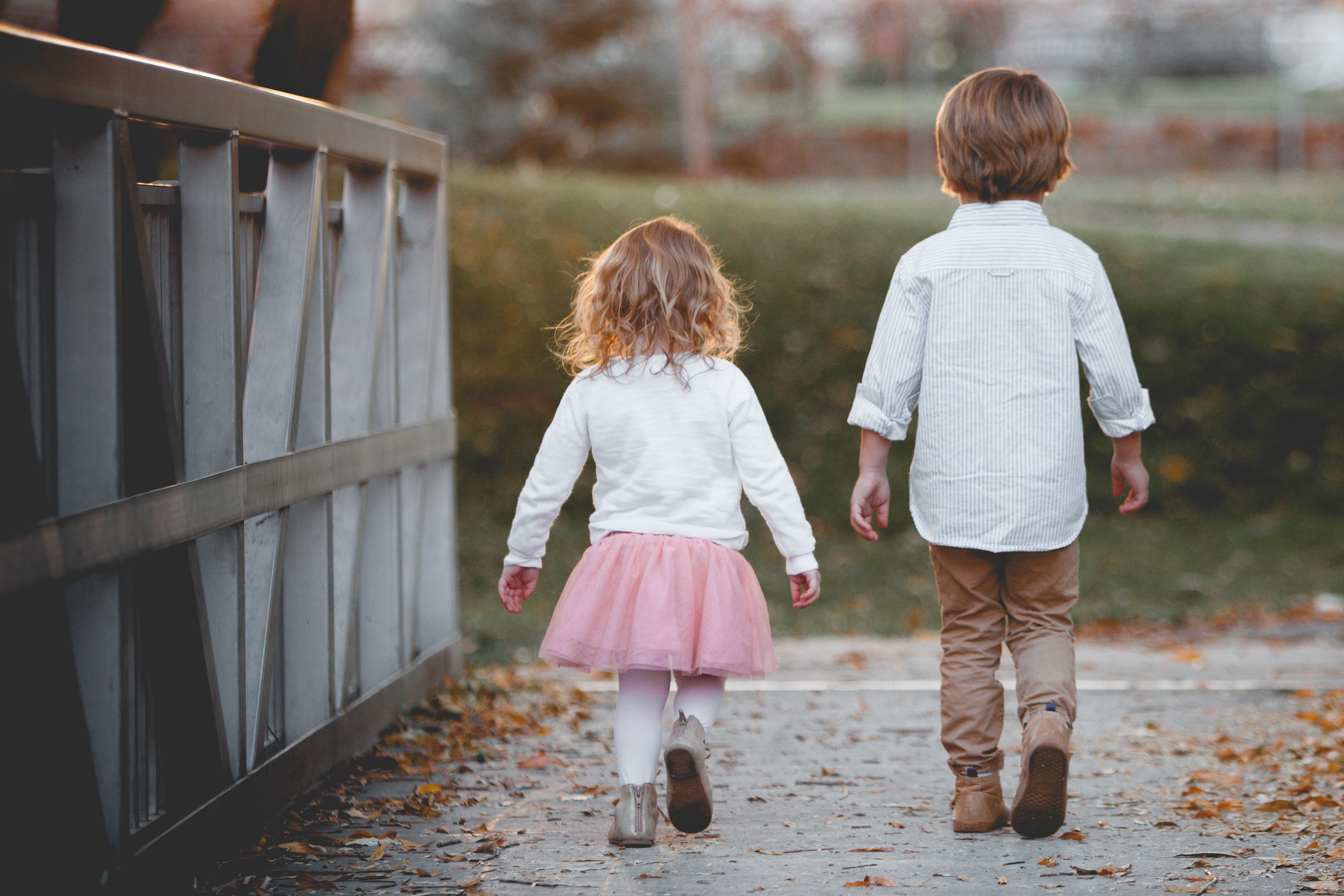 Children walking on a bridge together
