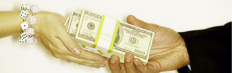 Man handing over money to woman