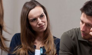 Woman looking at man with confused facial expression