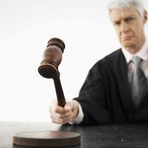stern judge banging his gavel