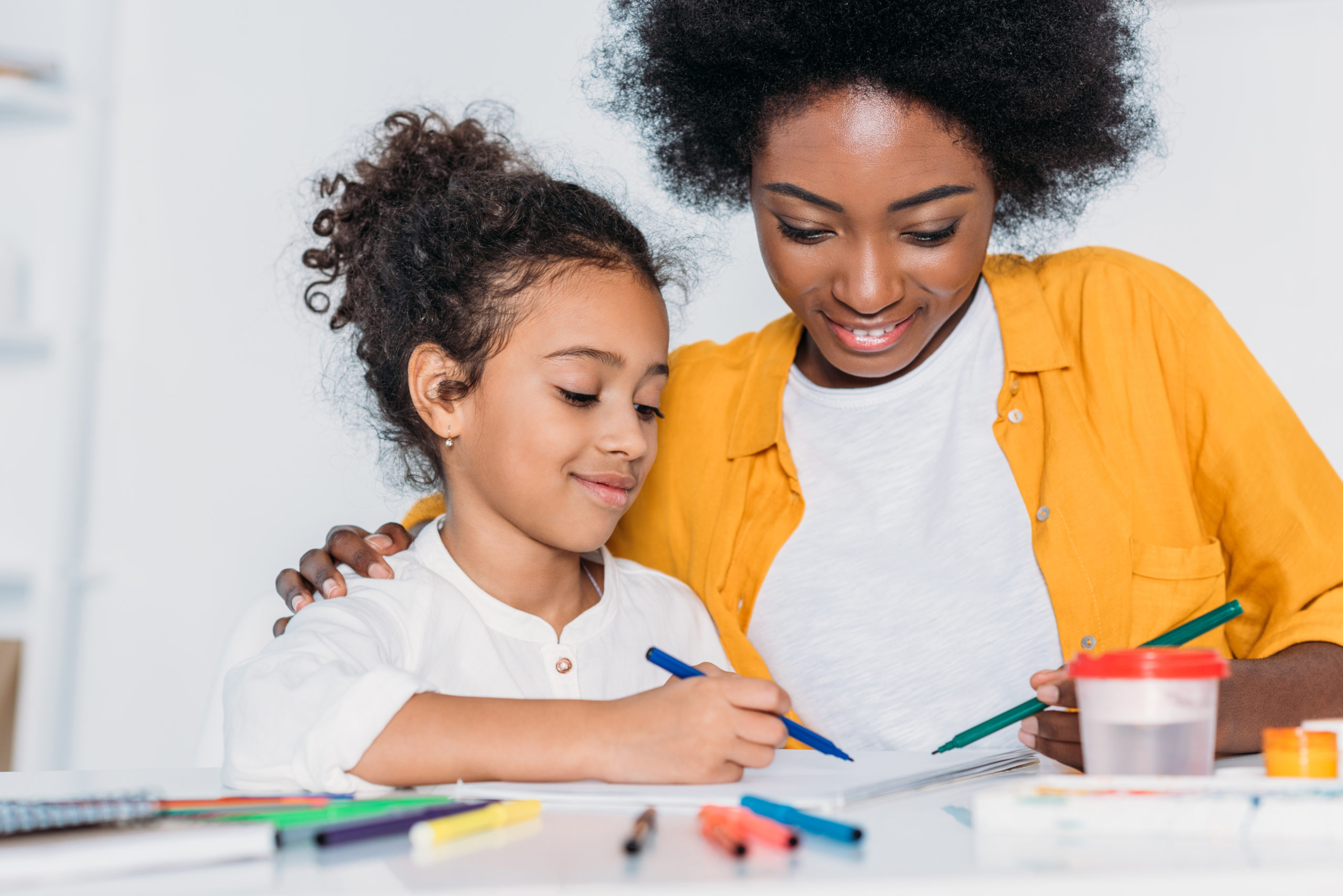 Single mother helping her daughter with her homework