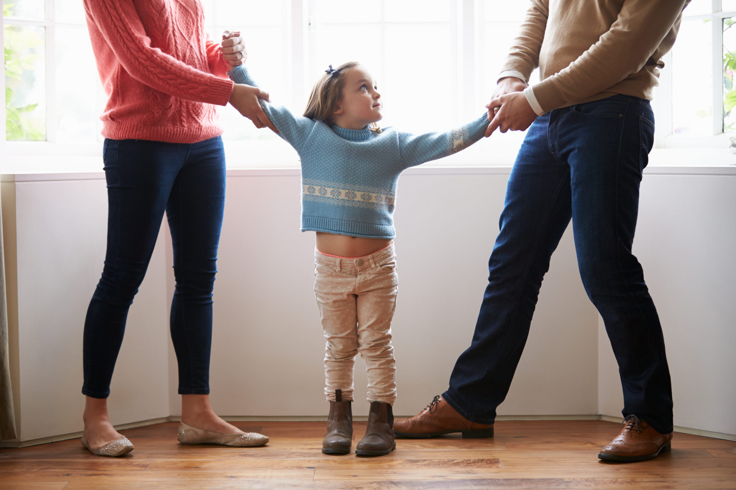 Daughter stuck in the middle of her parents
